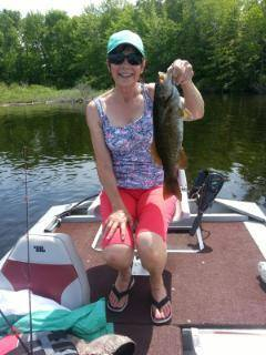 woman in shorts with bass from East Grand Lake