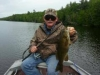 man in green with bass from East Grand Lake